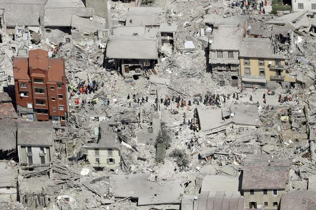 This aerial photo shows the damaged buildings in the town of Amatrice, central Italy, after an earthquake, Wednesday, Aug. 24, 2016. The magnitude 6 quake struck at 3:36 a.m. (0136 GMT) and was felt across a broad swath of central Italy, including Rome where residents of the capital felt a long swaying followed by aftershocks. (ANSA/AP Photo/Gregorio Borgia) [CopyrightNotice: Copyright 2016 The Associated Press. All rights reserved. This material may not be published, broadcast, rewritten or redistribu]
